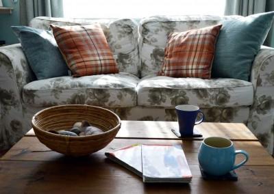 Planning walks in Chandler's Cottage living room
