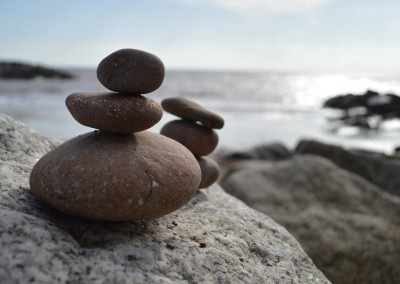 Balancing pebbles on Sidmouth beach