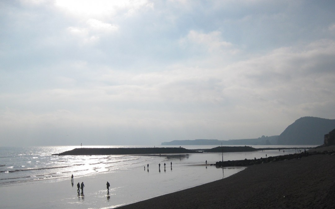 Photo: Walking on the beach in Winter sunshine
