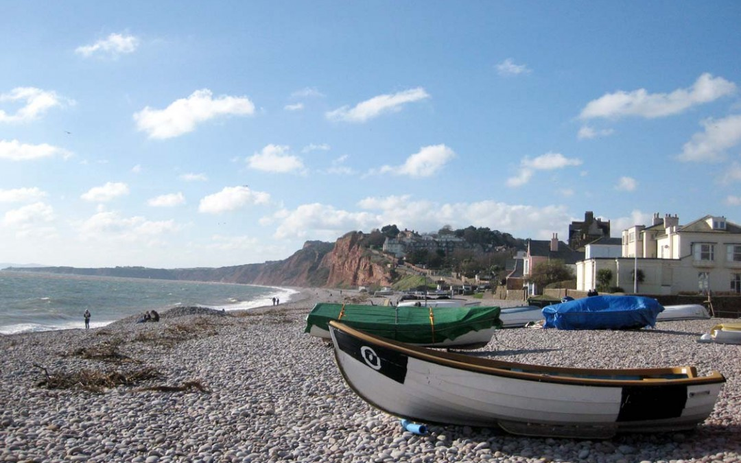 Photo: Boats on the beach at Budleigh Salterton