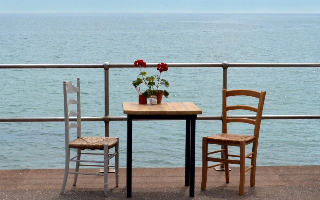 Photo: a table by the seaside at The Hideaway, Seaton