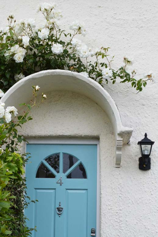 Photo: white roses over the front door