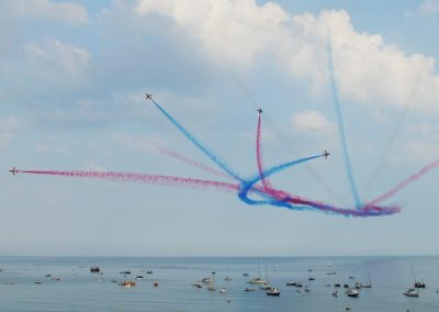 The Red Arrows over Lyme Bay during Lifeboat Week