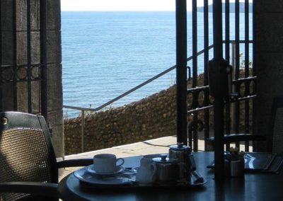 Photo: Afternoon tea overlooking the bay