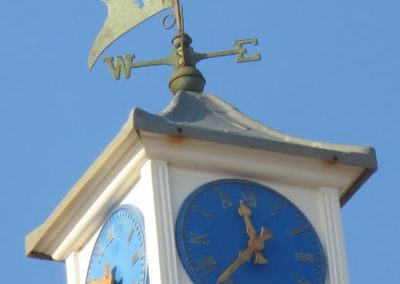 The clock tower on the cafe