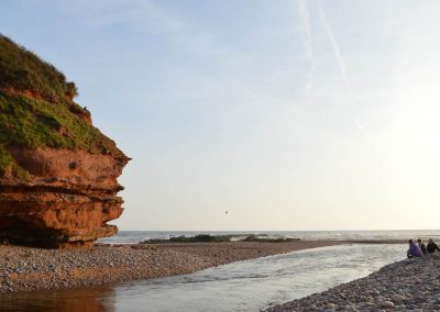 Photo: Red cliffs at the mouth of the Otter