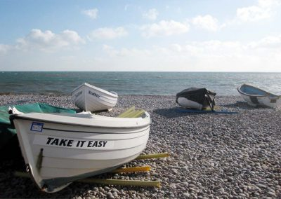 Photo: A boat with a message for visitors on Budleigh beach