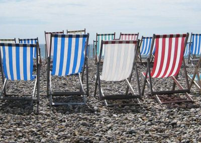 Deckchairs on the pebble beach at Beer